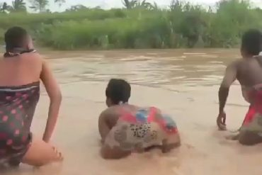 Three Nigerian Ladies Twerk Inside Dirty Water (Video)