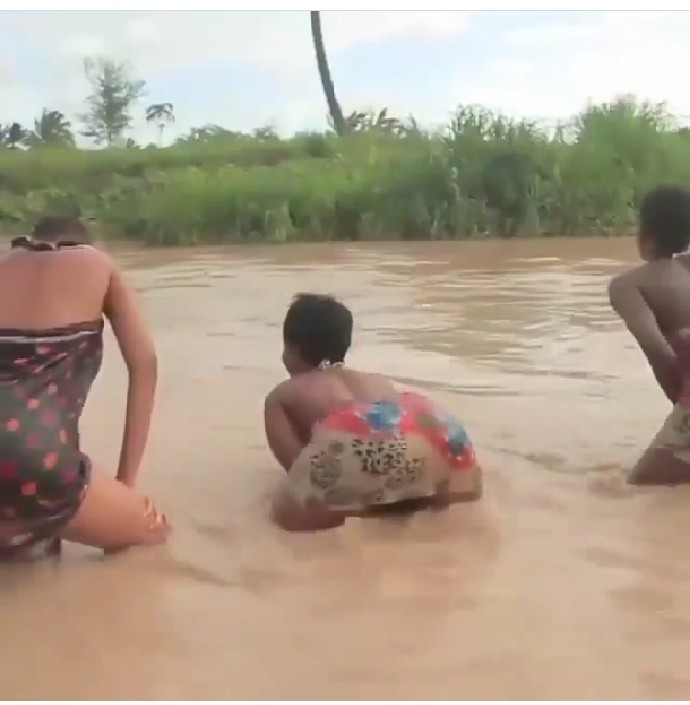 The three women inside the river