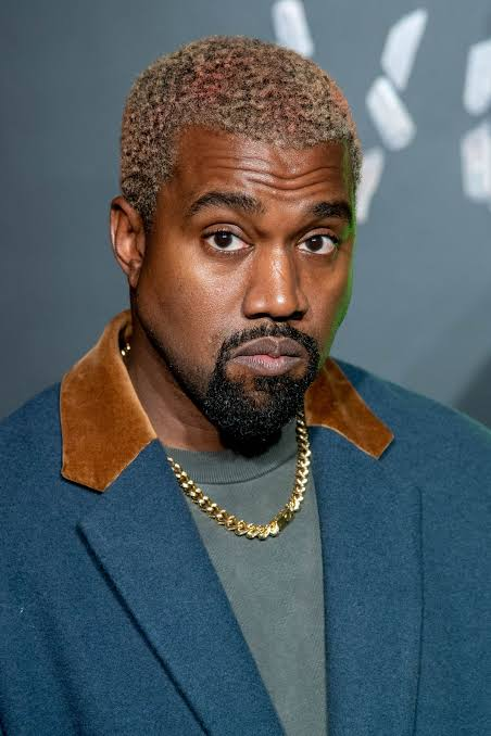 16F540F7 040A 4E43 88DF 5679E8E426F9 - Kanye West Dons Full Silver Outfit For New Show (Photo)