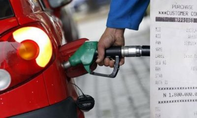 File photo of a car buying fuel and POS teller