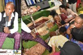 Pastor Lesego Daniel while feeding his church members