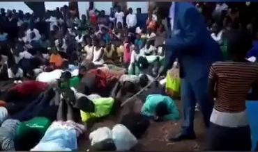 Pastor Paul Muwanguzi while flogging the church members