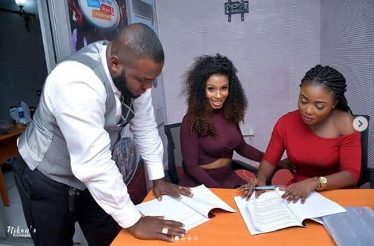 BBNaija Mercy Eke while signing the deal with Mapia tea