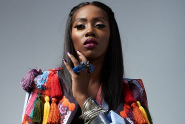 Excited Fan Grabs Tiwa Savage On Stage During Live Performance (Video)