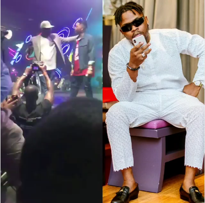 Photo of The Lagos big Boy while being escorted awy from Olamide by bouners