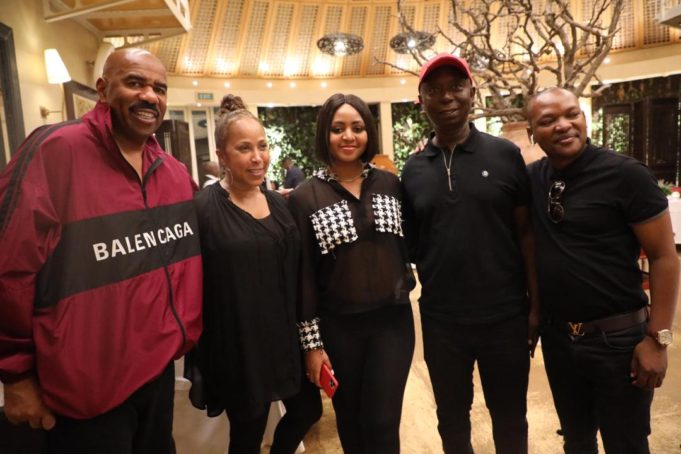 Ned Nwoko and Regina Daniels pictured with Steve Harvey and his family