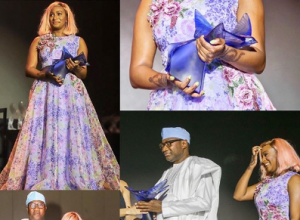 Femi Otedola and DJ Cuppy while picking up the award