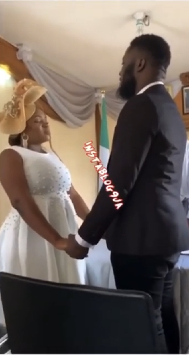 The bride and the groom exchanging their vows