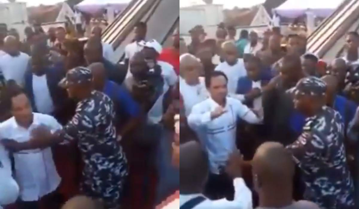 Prophet Chukwuemeka Odumeje being pushed by the police officer at the event