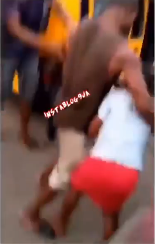 The lady in a red skirt beating the bus conductor