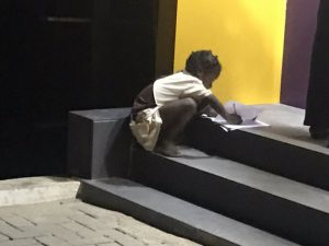 The young girl at the ATM spot