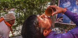 Men and women seen drinking the urine with cups (Photo credit: Getty Images)