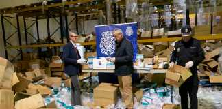 Galician regional vice president Alfonso Rueda (left) visiting the warehouse of a company where sanitary equipment was stolen in Santiago de Compostela, SpainXUNTA DE GALICIA/AFP via Getty Images