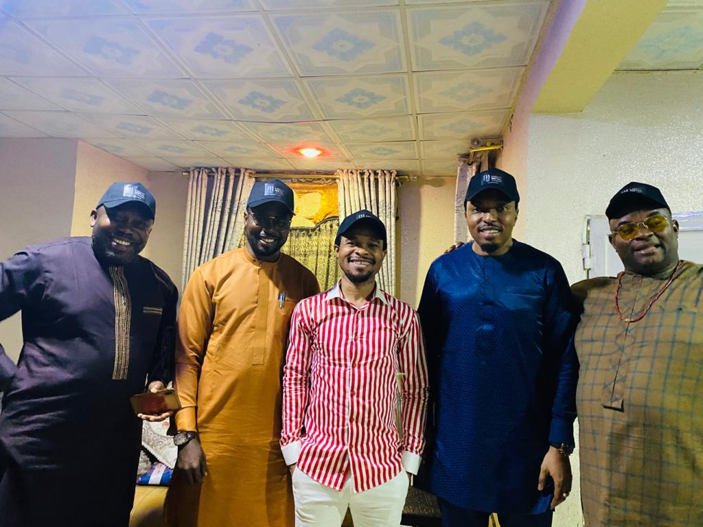 Pastor Odumeje pictured with members of the management firm
