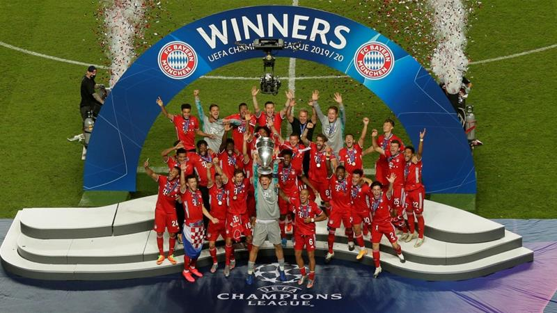 Bayern Munich players celebrate as captain Manuel Neuer lifts the Champions League trophy [Manu Fernandez/Pool