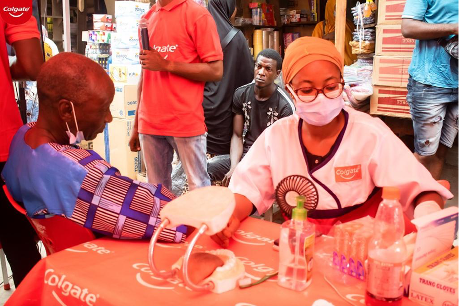 L-R: Mr. Isreal Ade, a beneficiary, being attended to by one of the dentists, Dr. Mariam Bello during Colgate Dental Checkup at Oke Aarin Market, Lagos.